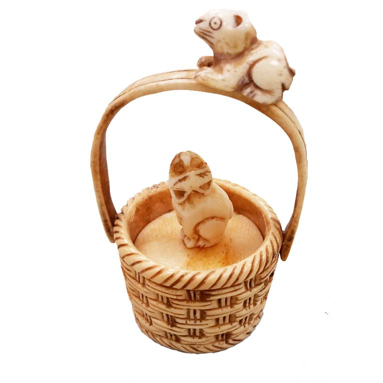 OX BONE CARVED BASKET W/ RABBIT